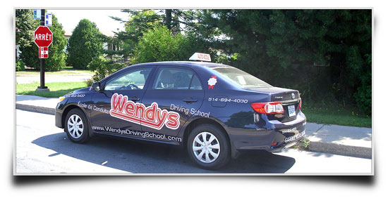approaching stop sign Wendys in Pincourt  Driving School