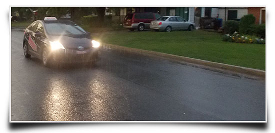 Driving lesson in the rain in Pincourt in a Toyota Prius