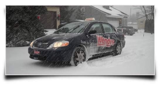 Driving lesson during a snow storm